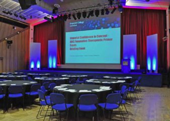 Stage set up for a conference in the Great Hall