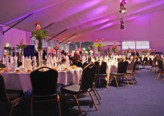 Dining event in marquee on the Queen's Tower lawn and terrace