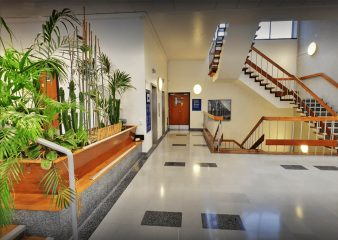 View of the stairs and plants in the Skempton Building