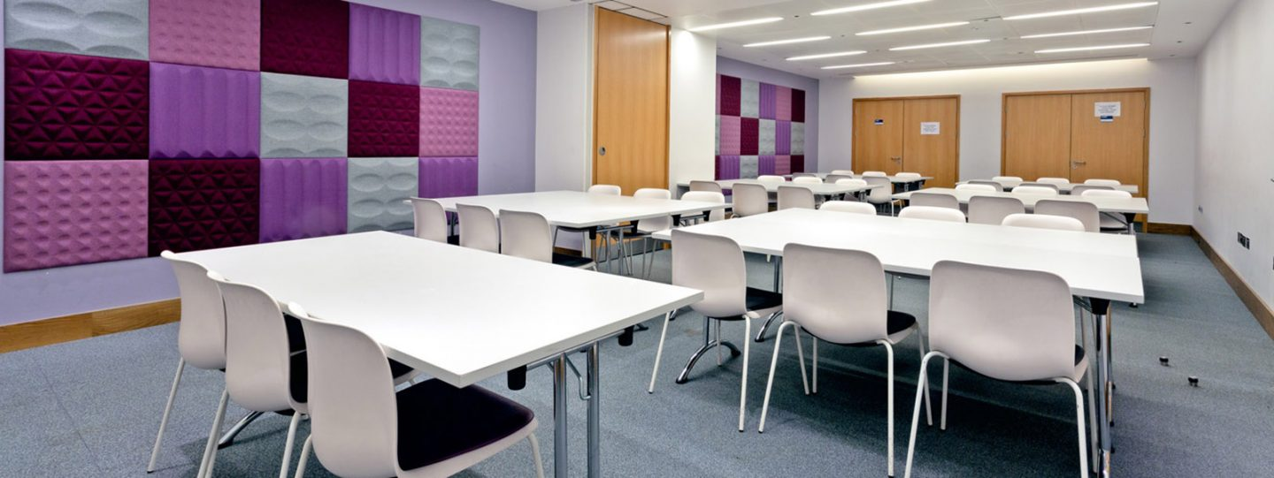 Tables and chairs in the Hbar classroom
